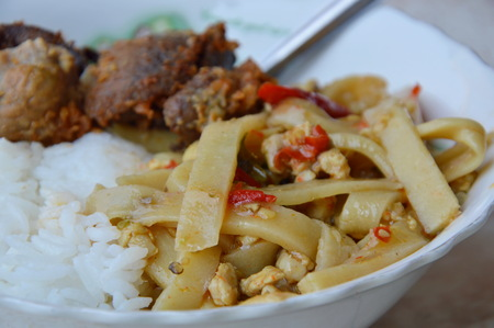 entrails: spicy bamboo shoot and deep fried chicken entrails on plain rice