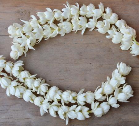 arrange: white jasmine arrange on wooden board