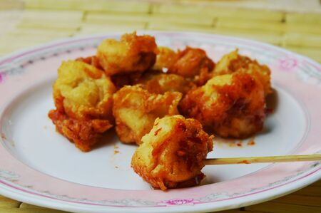 fish ball: deep fried fish ball and wooden stick