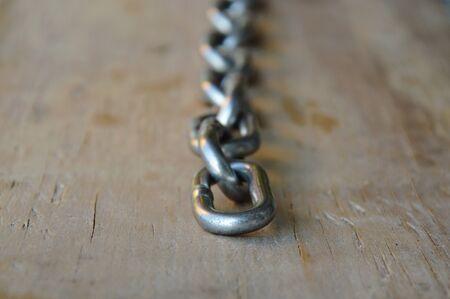 iron chain: iron chain on wooden board