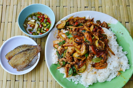 fish fry: spicy stir-fried mussel on rice eat couple with fish fry Stock Photo