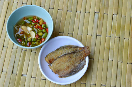 fish fry: fish fry on dish dipping with chili sauce