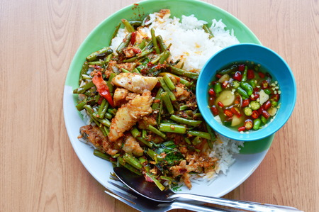 dolly: spicy stir-fried morning glory with dolly fish on rice