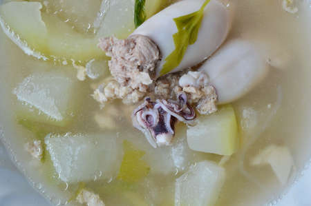 carne picada: winter melon and squid filled mince pork soup in bowl