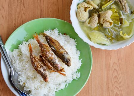 entrails: fried fish topping on rice and pickled Chinese cabbage with pork entrails soup Stock Photo