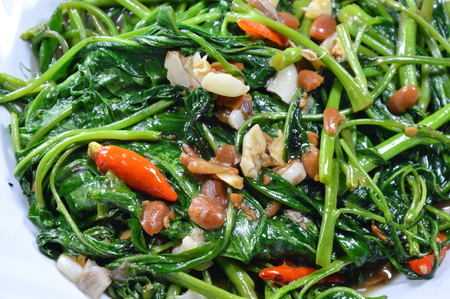 soy bean: stir fried morning glory with soy bean paste on dish