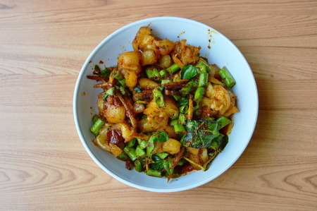 ligament: spicy stir fried pork ligament with herb on bowl