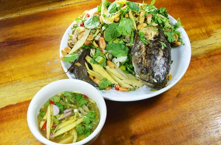 striped snake head fish: deep fried snake head fish with mixed herb and sweet sauce Stock Photo