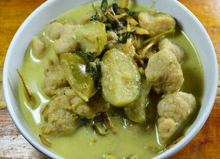 fish ball: green curry fish ball with eggplant in bowl