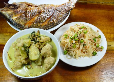 fish ball: green curry fish ball with eggplant eat couple with spicy rice noodle and deep fried fish Stock Photo
