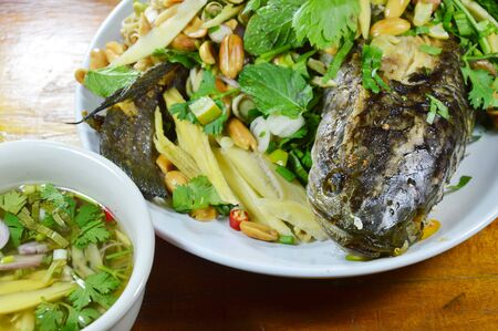 striped snake head fish: deep fried striped snake head fish with mixed herb dipping sweet sauce