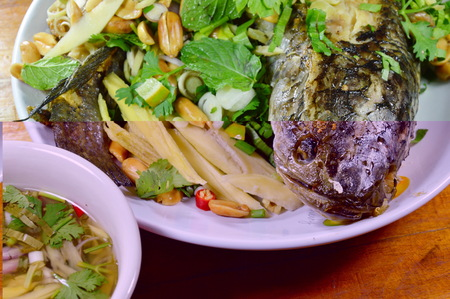 striped snake head fish: deep fried snake head fish with mixed herb dipping sweet sauce