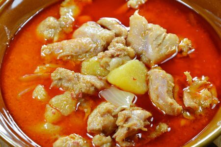 coconut milk: chicken curry with potato and coconut milk in bowl