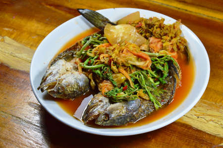 striped snake head fish: deep fried striped snake head fish in mixed hot and sour soup on dish