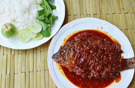 chili sauce: deep fried mango fish dressing chili sauce and plain rice Stock Photo