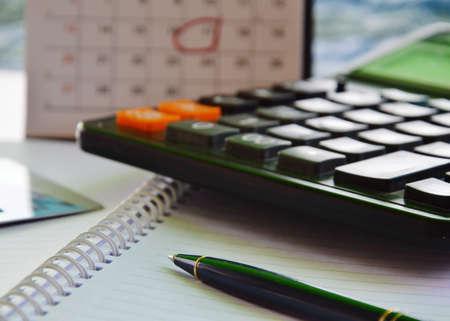 date book: pen on book and calendar marking deadline date background