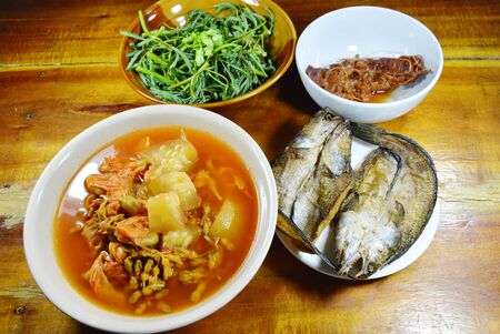 striped snake head fish: deep fried snake head fish eat couple with mixed vegetable Thai spicy and sour soup