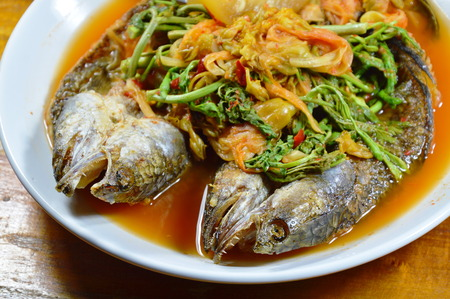 snake head fish: deep fried striped snake head fish in mixed hot and sour soup on dish