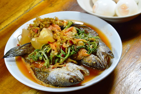 striped snake head fish: deep fried striped snake head fish in mixed hot and sour soup eat with boiled egg