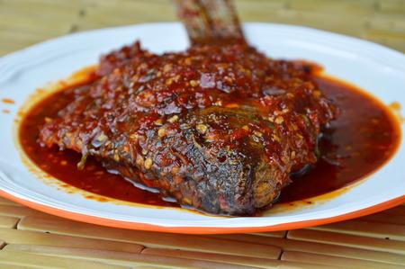 chili sauce: deep fried black mango fish dressing chili sauce on plate