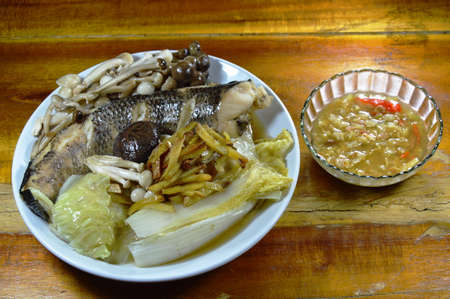 striped snake head fish: steamed striped snake head fish with mushroom and slice ginger dipping spicy soy bean sauce