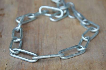 choke: stainless dog choke chain collar on wooden board