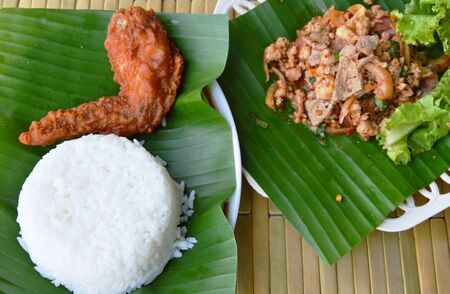 chicken chop: fried chicken wing and spicy chop pork salad eat with plain rice Stock Photo