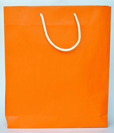 versatile: orange paper bag with white nylon handle