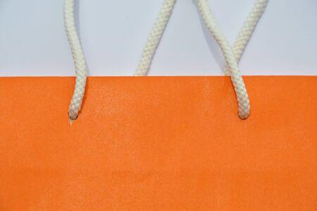 nylon: orange paper bag and white nylon handle