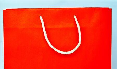 versatile: orange paper bag and white nylon rope handle