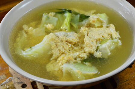 boiled egg: boiled egg with cabbage in hot soup on bowl Stock Photo