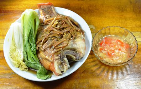 mango fish: steamed red mango fish with vegetable topping slice ginger dipping spicy sauce