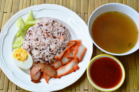 barbecued: barbecued red pork in sauce with brown rice and soup