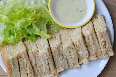 tuna mayo: tuna sandwich and sour cream sauce on dish