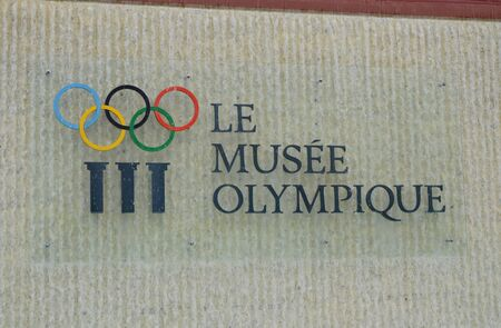 headquarter: Lausanne Switzerland June 3, 2014 sign and symbol of Olympic museum at main entrance office headquarter Editorial