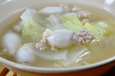 digest: boiled minced pork stuffed squid with Chinese cabbage hot soup in bowl Stock Photo