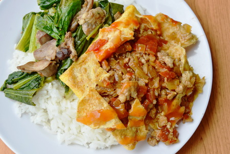 gizzard: stuffed omelet and stir fried Chinese cabbage with chicken entrails on rice Stock Photo