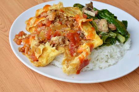 entrails: stuffed omelet and stir fried Chinese cabbage with chicken entrails on rice Stock Photo