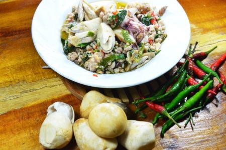 basil  leaf: spicy stir fried squid with mushroom and basil leaf on dish