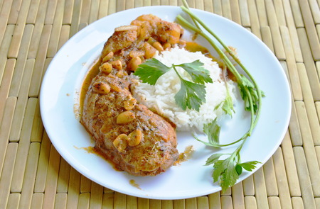 sweet and savoury: chicken leg spicy and sweet curry and plain rice on dish Stock Photo