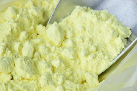 sulphur on iron scoop in plastic bag