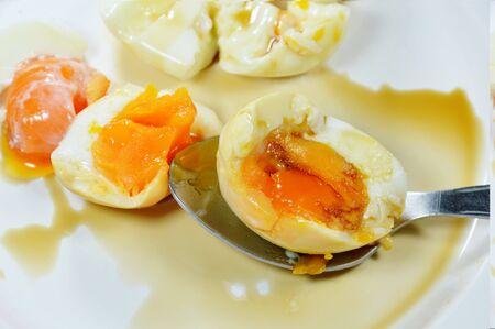 creamy: boiled egg with creamy yolk on spoon