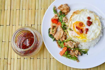 basil  leaf: spicy stir fried pork basil leaf and egg on rice with chili fish sauce