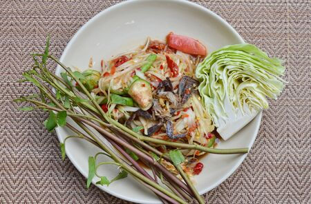 sour food: papaya and pickled crab salad taste spicy sweet and sour food