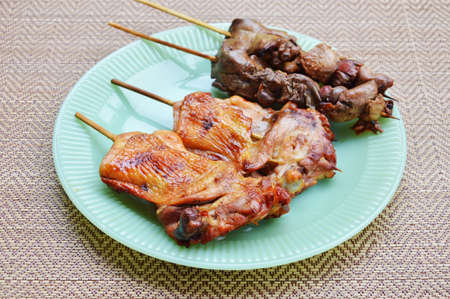 entrails: roasted chicken and entrails in wooden stick on dish