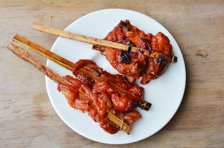 wooden stick: grilled chicken in wooden stick on dish Stock Photo