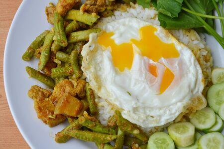 long bean: spicy stir fried yard long bean with fat pork curry and creamy egg yolk on rice
