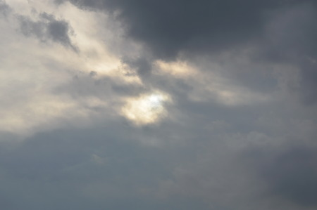 dull: rain cloud hide the sun on dull sky