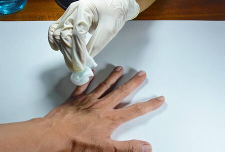 rubber glove: hand in medical rubber glove cleaning to the wound Stock Photo