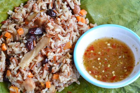 whole grain: steamed rice and whole grain wrapped in lotus leaf with spicy sauce